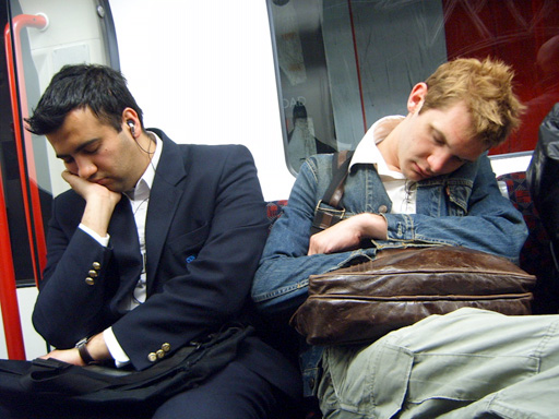 Two men asleep on the tube