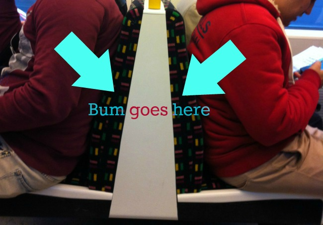 Arrows pointing to the space between the seats. Bum goes here.