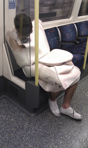 man dressed as toilet on tube